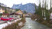 konak : Enjoy Alpine landscape and traditional architecture of Salzkammergut, observing narrow Traun river and small town of Ebensee, Austria.