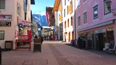 herenhuis : ZELL AM SEE, AUSTRIA - FEBRUARY 28, 2019: The old street of popular mountain resort with colorful edifices, cafes, restaurants, sport stores and souvenir shops, on February 28 in Zell Am See.