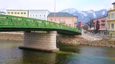 mesire : The old green bridge of Kaiserin Elizabeth connects the banks of Traun river with old edifices of Bad Ischl, Salzkammergut, Austria.