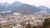 konak : The Siriuskogel mount offers the birds eye view on the town of Bad Ischl, its colorful housing, narrow Traun river and Jaizenberg mountain on the background, Salzkammergut, Austria.