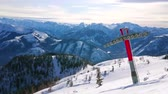 сноуборд : EBENSEE, AUSTRIA - FEBRUARY 24, 2019: Panorama of Feuerkogel mountain winter resort with cableway, skiers, snowy slopes of Dachstein Alps and Traunsee lake in valley, on february 24 in Ebensee.
