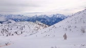 ski piste : Panorama of the snowy plateau of Feuerkogel mountain with ski lifts, trails, cable car top station and numerous sportsmen, Ebensee, salzkammergut, Austria.