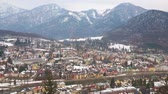 konak : Enjoy the panorama of Bad Ischl from the top of Sirius Kogel mount, overlooking the town, Traun river, and snowy Alps on background, Salzkammergut, Austria. Stok Video