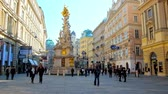 viyana : VIENNA, AUSTRIA - FEBRUARY 17, 2019:  Historical Graben street boasts one of the most outstanding monuments of city - Plague or Holy Trinity Column, decorated with gilt, on February 17 in Vienna.