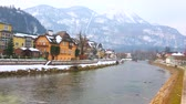 Observe the city, lying on the banks of Traun river with a view on snowy Mount Katrin on background, Bad Ischl, Salzkammergut, Austria.