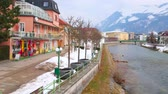 BAD ISCHL, AUSTRIA - FEBRUARY 20, 2019: Esplanade embankment with small park and line of traditional townhouses with tourist shops, cafes and art galleries, on February 20 in Bad Ischl.