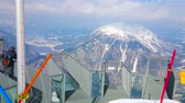 OBERTRAUN, AUSTRIA - FEBRUARY 21, 2019: The breath-catching Five fingers viewing platform of metal and glass on the edge of Krippenstein mount of Dachstein massif, on February 21 in Obertraun 動画素材