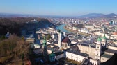 SALZBURG, AUSTRIA - FEBRUARY 27, 2019: Panorama of Altstadt (old town) from the Hohensalzburg Fortress with a view on churches, mansions, Salzach river and Castle terrace, on February 27 in Salzburg