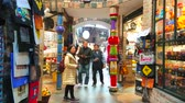 viyana : VIENNA, AUSTRIA - FEBRUARY 19, 2019: The busy alley of Hundertwasser Village covered market, lined with souvenir stores, craft shops and decorated with colored pillars, on February 19 in Vienna.