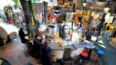 VIENNA, AUSTRIA - FEBRUARY 19, 2019: Interior of Hundertwasser Village - the covered market, with lounge bar amid the stalls and handicraft workshops, on February 19 in Vienna.