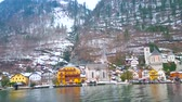 HALLSTATT, AUSTRIA - FEBRUARY 21, 2019: The ferry trip is the best chance to watch Hallstatt from Hallstattersee lake, enjoy its cityscape, Dachstein mountains and nature, on February 21 in Hallstatt