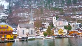 HALLSTATT, AUSTRIA - FEBRUARY 21, 2019: Hallstattersee lake trip with a view on old Hallstatt, its houses, churches of Christ and St Mary of the Mount with its Beinhaus, on February 21 in Hallstatt Stok Video