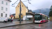 GMUNDEN, AUSTRIA - FEBRUARY 22, 2019: The tram stops at the station in Kapuzinerplatz (square), next to historic building of Kapuziner Kloster (monastery), on February 22 in Gmunden.