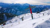 EBENSEE, AUSTRIA - FEBRUARY 24, 2019: The snowy Feuerkogel mountain slope with modern chairlift and skiers, going downhill, on february 24 in Ebensee. 動画素材