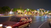 pavilion : BANGKOK, THAILAND - MAY 1, 2019: Time lapse of the speed traffic in evening Ratchadamnoen Avenue, lined with trees, covered with lighting garlands, on May 1 in Bangkok Stock Footage