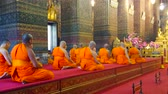 BANGKOK, THAILAND - APRIL 22, 2019: The bhikkhu monks pray during the worship in Phra Ubosot of Wat Pho Buddhist complex, on April 22 in Bangkok