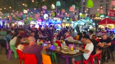 CHIANG MAI, THAILAND - MAY 2, 2019: The crowded open air food court of Night Bazaar, surrounded by small cafes and street food stalls, on May 2 in Chiang Mai