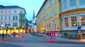 BAD ISCHL, AUSTRIA - FEBRUARY 20, 2019: The colorful dense buildings of Pfarrgasse street in dimmed evening city lights, on February 20 in Bad Ischl