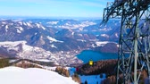Enjoy Alpine landscape, clear surface of Wolfgangsee lake and vintage cableway from the  Zwolferhorn mountain peak, St Gilden, Salzkammergut, Austria