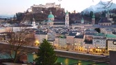 Enjoy superior evening cityscape of Salzburg with Hohensazburg Castle on Festunsberg Hill, Cathedral (Dom), old mansions and Salzach river from the top of Kapuzinerberg hill, Salzburg, Austria