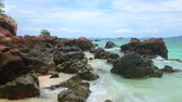 인도 차이나 : The coastal rocky landscape of Khai Nai island with a view on many red boulders, covering white sand beach, Phuket, Thailand