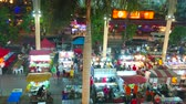 kolumny : PATONG, THAILAND - MAY 1, 2019: Panorama  of Banzaan Night Bazaar with many street food stalls, outdoor cafes and clothing stores, located under the giant canopy with tall columns, on May 1 in Patong