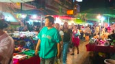 pavilion : CHIANG MAI, THAILAND - MAY 2, 2019: People walk along the narrow alley among the tiny stalls of Warorot Night Bazaar, on May 2 in Chiang Mai