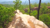 ecotourisme : Impressive landscape of Pai Canyon (Kong Lan) with narrow cliffs of dehydrated yellow clay, rising above the forest level, Thailand