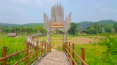 poep : Gate of Su Tong Pae Bamboo Bridge with inscription of its name - Bridge of Faith and Success; this construction stretches along the paddy fields of local villagers, Mae Hong Son suburb, Thailand