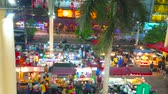 stragan : PATONG, THAILAND - MAY 1, 2019: Panorama  of Banzaan Night Bazaar with many street food stalls, outdoor cafes and clothing stores, located under the giant canopy with tall columns, on May 1 in Patong
