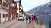 konak : HALLSTATT, AUSTRIA - FEBRUARY 21, 2019: Hallstattersee lake promenade is lined with old townhouses, tourist stores, art galleries, cafes and souvenir shops, on February 21 in Hallstatt