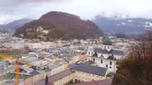 conservar : Monchsberg Hill is nice place to observe the cityscape with classical edifices, narrow streets, Collegiate Church of University (Kollegienkirche), Kapuzinerberg Hill and Salzach river, Salzburg, Austr Stock Footage