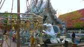 bo : CHIANG MAI, THAILAND - MAY 4, 2019: The metal prayer leaves (Bo, Bodhi tree) in front of Buddha Image and ornate Silver Temple (Wat Sri Suphan), on May 4 in Chiang Mai