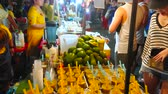 ült : CHIANG MAI, THAILAND - MAY 4, 2019: The wide range of fresh juices in stall of Saturday Night Market in Wualai walking street, on May 4 in Chiang Mai