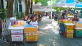 chao phraya : BANGKOK, THAILAND - APRIL 22, 2019: The market at Tha Chang pier with wide range of tropic fruits, fresh juices, snacks and other Thai street foods, on April 22 in Bangkok