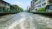 úzký : BANGKOK, THAILAND - APRIL 24, 2019: Enjoy the fast trip through the narrow Klong Saensaeb canal, lined with shabby living quarters, slums and narrow streets,  on April 24 in Bangkok
