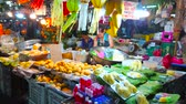 lanna : CHIANG MAI, THAILAND - MAY 4, 2019: The stall of Gate Market with fruits and mango sticky rice ingredients is decorated with colorful Lanna lanterns, fluttering in the wind, on May 4 in Chiang Mai