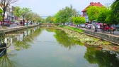 sightseeing : CHIANG MAI, THAILAND - MAY 4, 2019: The old town moat, that surrounds the medieval fortress, today its lined by lush trees and busy roads, on May 4 in Chiang Mai