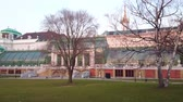 konak : VIENNA, AUSTRIA - FEBRUARY 18, 2019: The beautiful Palm House Palace with glass roof is one of the most notable landmarks of Burggarten, it functions as the butterfly house, on February 18 in Vienna Stok Video