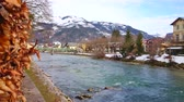 mesire : The view from Esplanade embankment on fast Traun river, snowy mountains, historical edifices and green Elizabethbrucke bridge, Bad Ischl, Salzkammergut, Austria