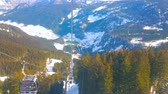 cabaña en el bosque : GOSAU, AUSTRIA - FEBRUARY 26, 2019:  Enjoy Alpine scenery from Panorama Jet Zwieselalm cable car, riding along the Zwieselalm mountain slope, on February 26 in Gosau