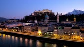 bell : The viewpoint on Kapuzinerberg hill is the best place to watch Salzburg castle, illuminated old town buildings and Salzach river on blue hour, Austria Stock Footage