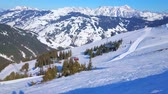 gondole : The slope of Schmitten mount - the main winter attraction of Zell am See, famous among skiers, snowshoers and other sportsmen and active tourists, Austria