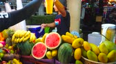 調理器具 : PATONG, THAILAND - MAY 1, 2019: The seller of fresh juice bar in Banzaan Fresh Market prepares ice cocktails of tropical fruits (banana, mango, papaya, pasion fruit), on May 1 in Patong