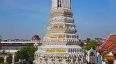 quai : BANGKOK, THAILAND - APRIL 23, 2019:  Observe the corner prang of Wat Arun, richly decorated with tilling, sculptures of mythical creatures and faience relief ornaments, on April 23 in Bangkok