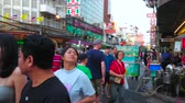 snackbar : BANGKOK, THAILAND - APRIL 23, 2019: Busy Yaowarat road is central shopping area in Chinatown with many stores, cafes, street vendors, market stalls, hotels and restaurants, on April 23 in Bangkok
