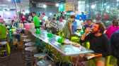 snackbar : BANGKOK, THAILAND - APRIL 23, 2019: The busy roadside restaurant in Yaowarat avenue with wide range of Chinese and Thai dishes, cool drinks, on April 23 in Bangkok