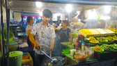 ateş : PATONG, THAILAND - MAY 1, 2019: The chef of small cafe cooks stir fry vegetables  in open air kitchen of Bangla streets food court, on May 1 in Patong