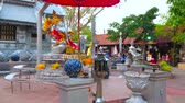 prata : CHIANG MAI, THAILAND - MAY 4, 2019: The altar of Ganesha shrine with chatra umbrella and floral garlands, located on Silver Temple (Wat Sri Suphan) grounds, on May 4 in Chiang Mai