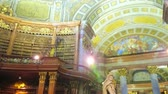strop : VIENNA, AUSTRIA - MARCH 2, 2019: The splendid frescoes on the dome in the Prunksaal Hall of National Library and marble sculpture of Emperor Charles VI in Roman clothes, on March 2 in Vienna